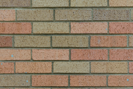 planar: background of random orange green tone brick wall, pattern, close up