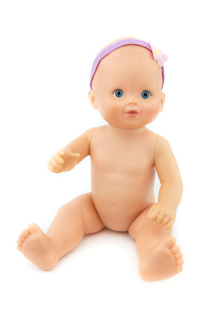 thrift shop naked baby girl doll, sitting on isolate background, raising arm