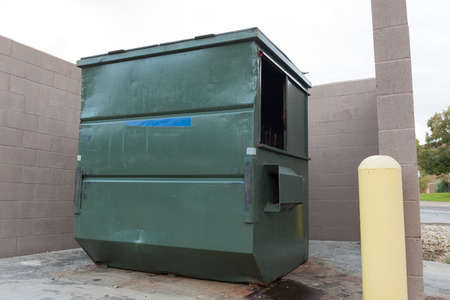environmental sanitation: big green dumpster isolate background Stock Photo
