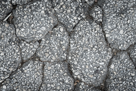 the road surface: crack surface asphalt road, texture close up
