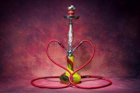 habbit: still life smoking shisha with heart shape double hose Stock Photo