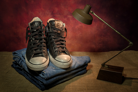 still life men accessories, black shoes, boots, jeans