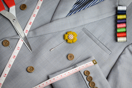 close fitting: cutting, tailored equipments on double breasted suit, measurement tape, scissors, thread coil Stock Photo