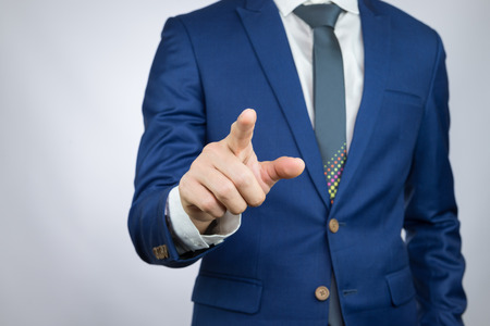navy blue suit: businessman pointing index finger, action of touch screen