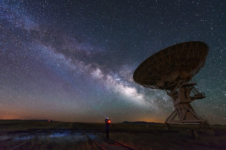 earth core: Milky way and big antenna dish at Very Large Array, New Mexico, USA. Powerful telescope for astronomy searching Stock Photo