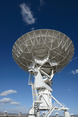 Huge antenna dish at Very Large Array, searching for imaging signal in space