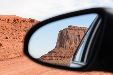 monument valley view: The mittens, Mesa, view from rear mirror at Monument Valley, Navajo Tribal Park, Arizona USA Stock Photo
