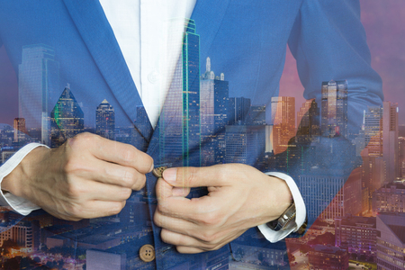 bottons: Man in blue suit two bottons, doing button. Double exposure elegant man and big city at night with many city light showing big city dress code. Business casual dress double exposure.