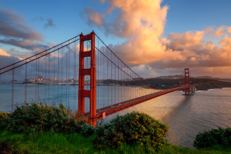 Beautiful Golden Gate the entrance to San Francisco, California, USA. Sunset and orange cloud in the sky. Imagens