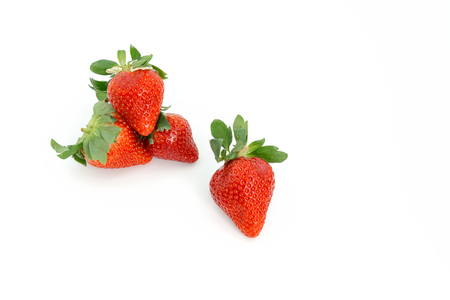 Fresh Strawberries on white background. Piling up and arranging in order.