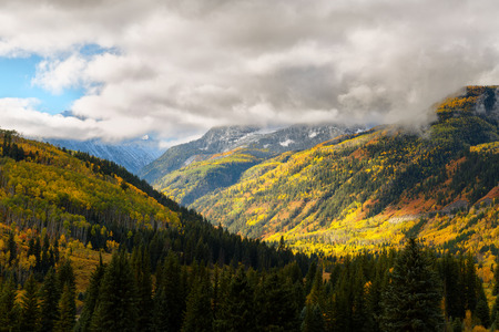 Fall foliage color and big mountain with snow on top in Marble county