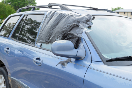 Broken window of a car by thief.