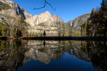 Reflection of water fall and mountain at Cooks meadow, Yosemite National park, California Zdjęcie Seryjne