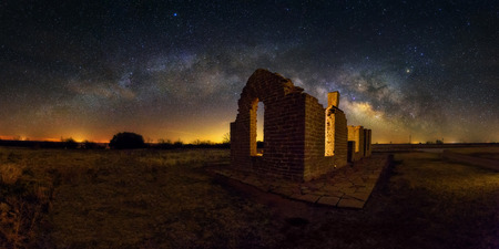 Panorama Milky way shot with ruined building at Fort Griffin State Historic site  Texas USA Stock Photo