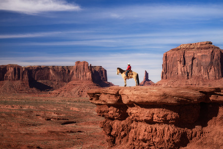 beautiful scene of Native American sitting on a horse in Monument Valley, Utah - Arizona State, America. Stock Photo