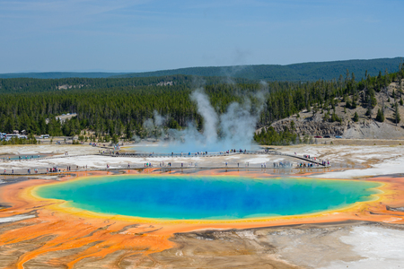 Famous trail of Grand Prismatic Springs in Yellowstone National Park from high angle view. Beautiful  hot springs with vivid color blue green orange in Wyoming. Zdjęcie Seryjne