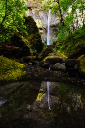 Elowah Falls in July, Oregon, USA. High and beautiful water falls with plenty of water flowing