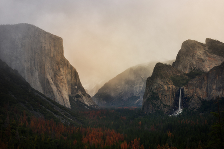 Tunnel View at sunrise and fog in Yosemite National Park, California, United States of America. El Capitan and Half Dome. Stock Photo