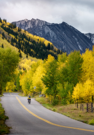 Beautiful fall color road in Ashcroft Ghost Town and bicycle trail. Stock Photo