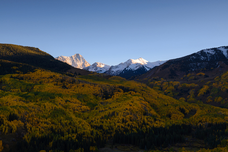 Fall foliage color Capital Peaks, snowmass village, Colorado. Aspen golden during Autumn season. Stock Photo