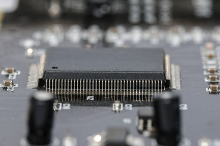 Electronics. Motherboard close up. Semiconductors, nanotechnology and engineering. Grain added Stock Photo