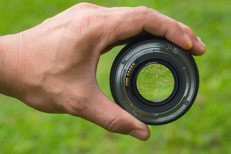 shootting: Mobile lenses on a green lawn.