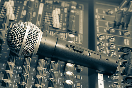 audio mixer: Audio mixer and microphone. Stock Photo