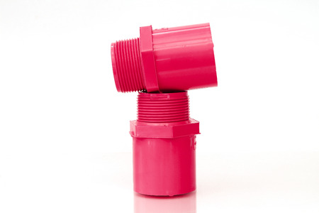 loosen: PVC pipes and joints unanimously red. On a white background Stock Photo