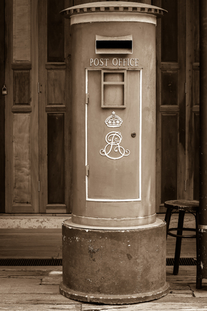 pillar box: Brown rusty old mailbox.