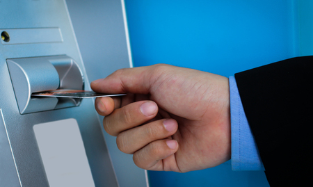 personal identification number: Mobile business partner transactions on ATM machine. Stock Photo