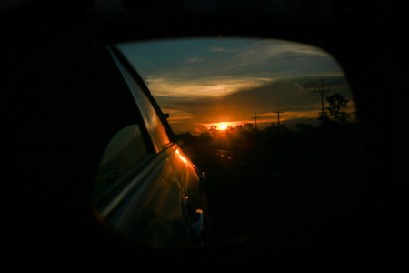 red evening: Red evening sun Looking through the car side mirror.