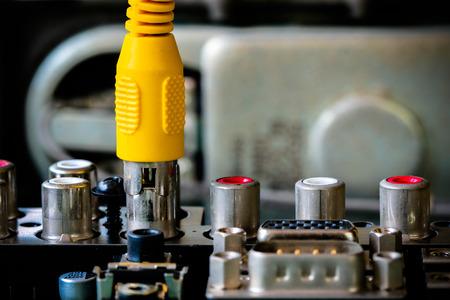 av: Hand connecting AV cables to AV Receiver. Stock Photo