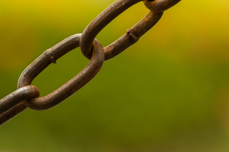 secrete: Secure, danger zone,The chain used to break the old territory On the green. Stock Photo