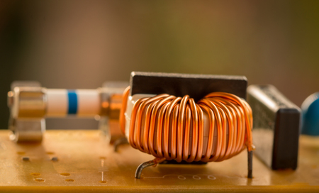 electromagnetic: Electromagnetic coil,inductor. Small winding coils and capacitors are mounted on a baseplate.