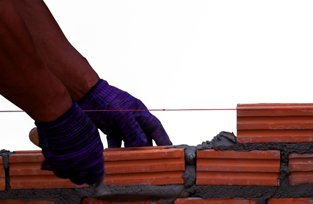 brick mason: Mason brick walls were formed by using the work placement is patterned brick alternating rows up from the floor up. By a qualified technician Stock Photo