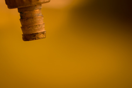 faucet, arid, drought, Global. Closeup faucet, no water for the old background. Hot colors Stock Photo