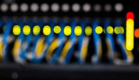 flashing: Switch Ethernet networks blur with flashing LED inside server cabinets. Stock Photo