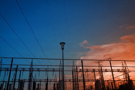 Electricity power station,Power distribution system to sunset sky background. Imagens