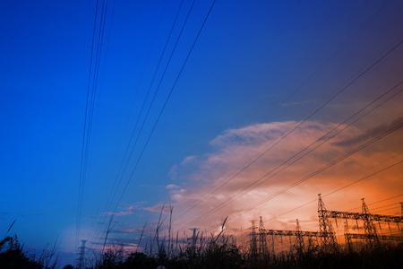 Electricity power station,Power distribution system to sunset sky background. Standard-Bild - 111357172