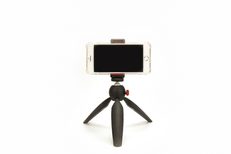 smart phone and tripod isolated on white background. Standard-Bild - 111357186