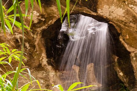 Miracle of Saeng Chan Waterfall (Long Ru Waterfall), Ubon Ratchathani Province, Thailand.The stone holes are caused by water erosion due to sandstone being less resistant to corrosion. Standard-Bild - 128945589