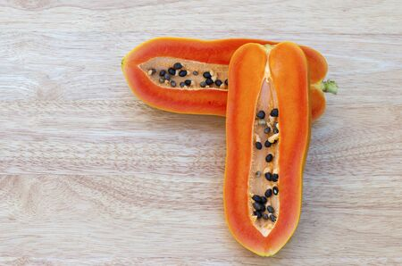 Healthy papaya, food and fruit placed on a wooden table in the warm natural morning. Stok Fotoğraf