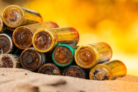 Old battery leak isolated / Hazardous waste concept/The battery is worn out. Archivio Fotografico