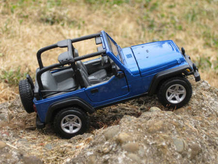 Passenger side of a 4X4 Rubicon on a rock formation Stock Photo - 7817042