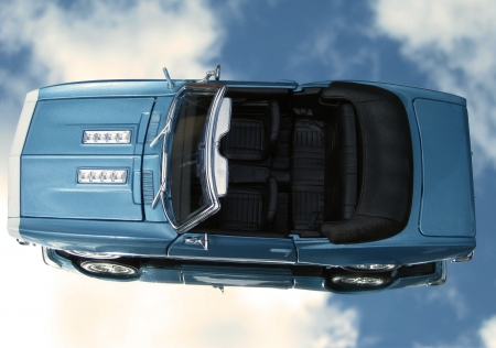 1968 Blue Camaro SS 396 Convertible Metal Car Isolated On A Mirrored Sky Background. Stock Photo