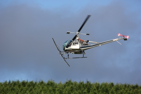 Pilot in-flight in a crop dusting agriculture helicopter