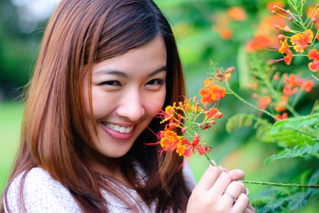 Woman and flower - in love Stock Photo