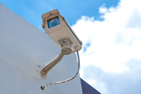 security eye: CCTV security camera at home and blue sky