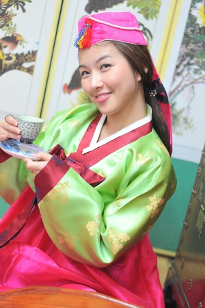 Woman asian drinking tea hanbok dress korea