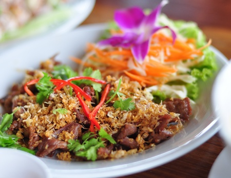 Thai food pork fried with garlic photo